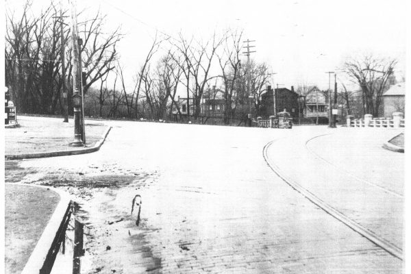 A view of the bridge from what is now the corner of Campbell Ave and Route 4 / Mill Street.  Note the completely different road and bridge orientation, cobble stone streets, and street car tracks.