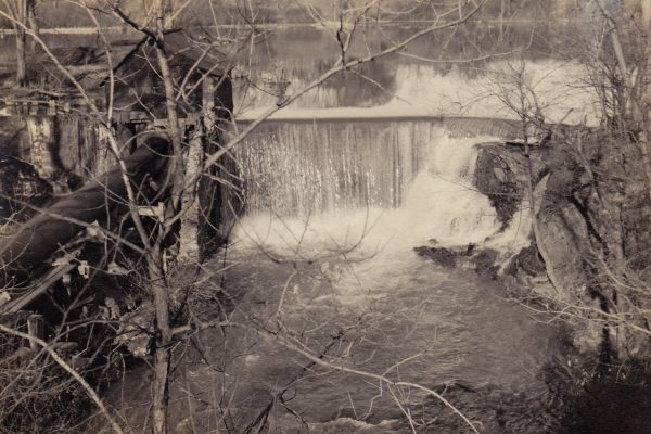 Smart's Pond dam on the Wynantskill Creek in Troy, behind the present Cumberland Farms on Campbell Ave., taken by Fred Backhaus in 1948.  Note the pipeline and gatehouse on left side for the hydroelectric plant that was down the hill at Burden Pond.  The hydroelectric plant provided power to the Albia Paper and Box plant a couple of miles away on Pawling Ave. near Winter St. from 1905 to 1955.  Part of the right side of the dam was breached many years ago, and what was left standing was knocked down by the Hurricane Irene flooding.